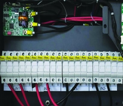 To facilitate cooling and prevent overheating, manufacturers may recommend alternating input conductors, as shown here, so that every other fuseholder has a 30 A fuse and the rest of the inputs are unused, with the fuses removed.