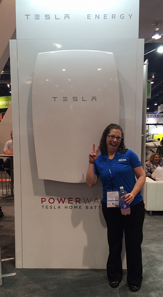 Me, standing next to the Tesla Powerwall %u2013 definitely not a 1-person carry piece of equipment.